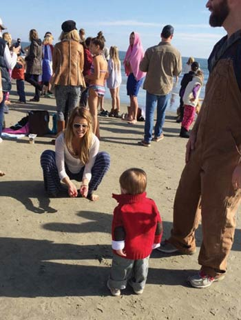 Crowded beach at the Dunleavy's Polar Bear Plunge