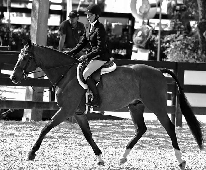 Grayson Schirmer riding horseback (black and white photo)